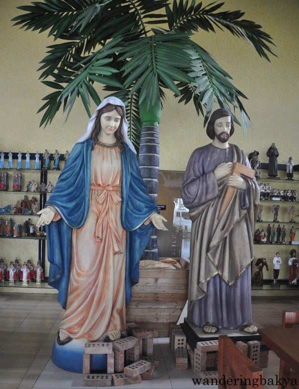 Larger-than-life images of Mary and Joseph welcome visitors at Caffé San'Antonio.
