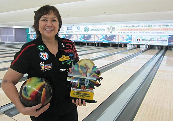 """Olivia """"Bong"""" Coo and her bowling trophy. Photo from magallanesbowling.com"""