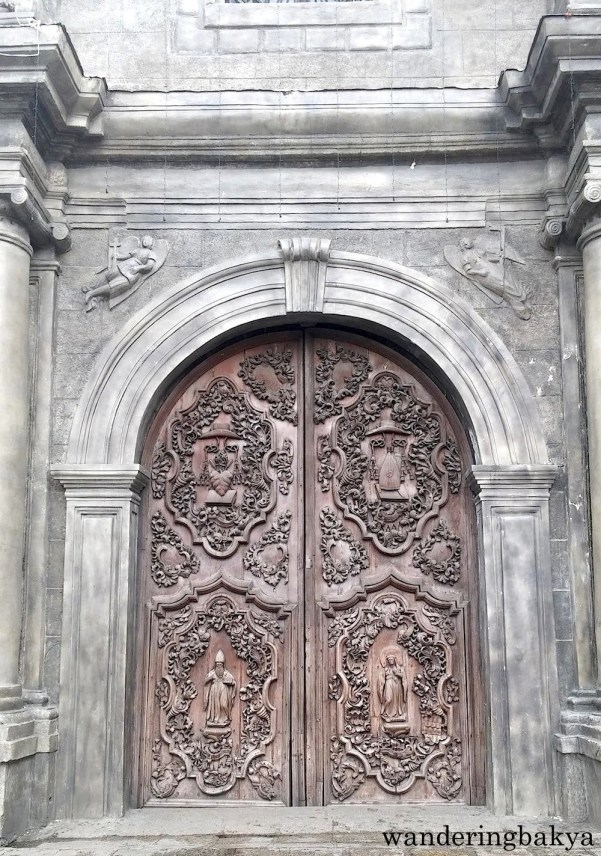 The heavily ornate double door of San Agustin Church.
