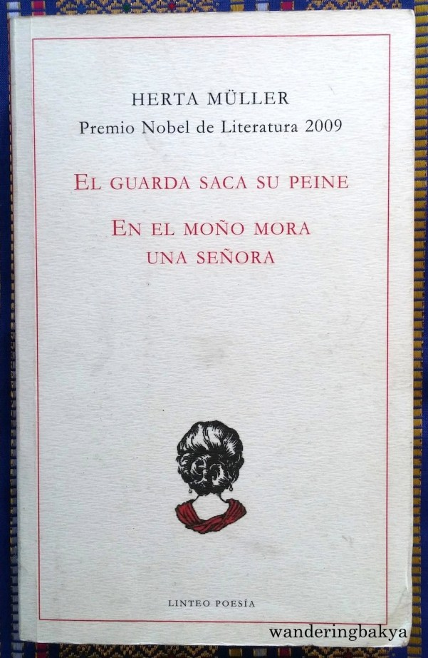 El Guarda Saca su Peine / En el Moño Mora Una Señora by Herta Müller. It is a compilation of poems. In the four years that it has been with me, I have read 230 out of 399 pages before I forgot about it. The bookmark is still there.