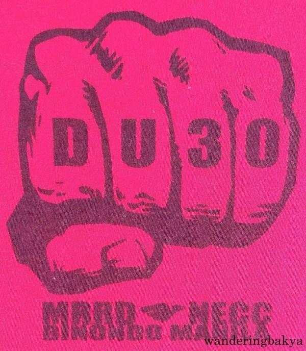 The back of Duterte shirt from MRRD – NECC Binondo, Manila. The iron fist represents the iron-fisted president that Duterte (DU30) will be.