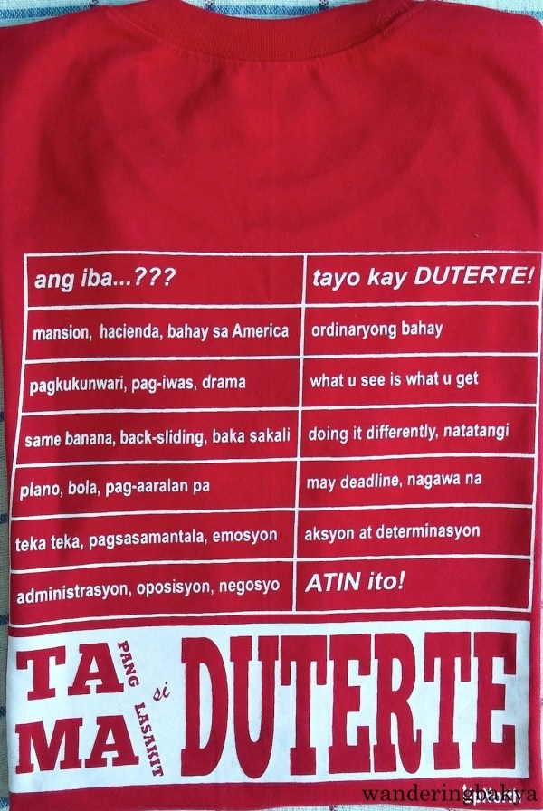 """The back of """"Duterte Presidente"""" shirt from UpNorth. It has a chart the differentiates Duterte from other presidential candidates (ang iba)."""