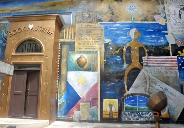 The main door of The Book Museum and part of the mural. The mural shows the evolution of local and international printing. It is hand-painted by Baguio visual artist Leo Aguinaldo.