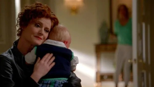 Devious Maids' Evelyn Powell (Rebecca Wisocky) in one of her rare tender moments. Photo from mylifetime.com