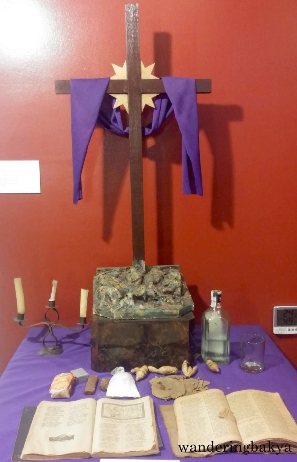 Pasyon: Holy Week altar for chanting of the Pasiong Mahal, text recounting life and passion of Christ. On the altar are copy of Pasyong Mahal on twill woven rattan cloth, newsprint and Pasion Bicol and Kristo, wooden sculpture of crucified Christ