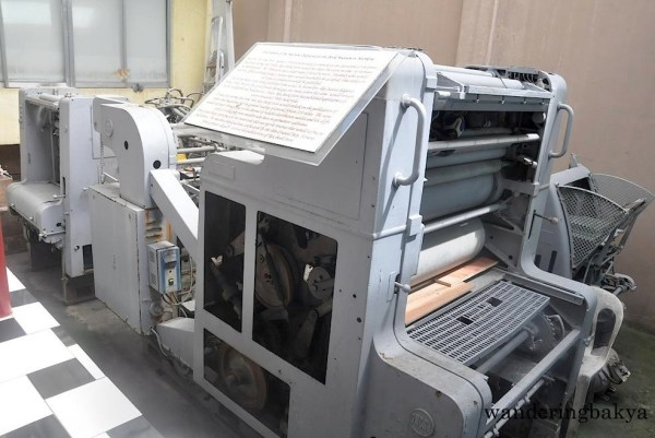 Behind James Dean's life-size statue is this printing press. This machine was confiscated by then Counsel Atty. Soriano from a printer illegally copying the publications of Rex Book Store.