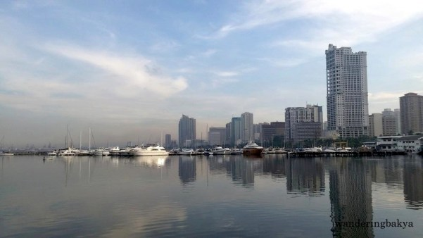 The view of docked boats and buildings along Roxas Boulevard from Harbour Square at around 7am.