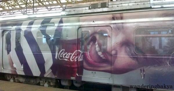 "Part of the ""Taste the Feeling"" Coke wrap ad on LRT Line 2 train."