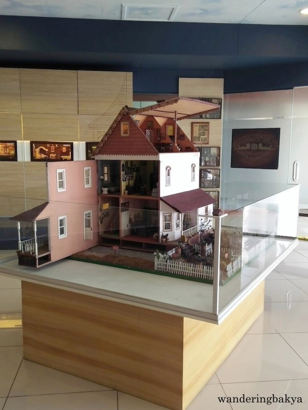This doll house is the centerpiece of Museum of Miniatures. It has a lot of miniature items cramped in its floor area.