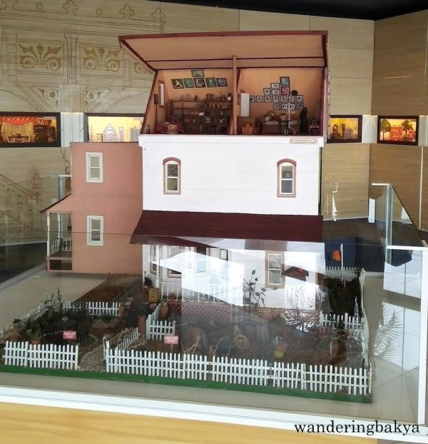 The miniature doll house from one side