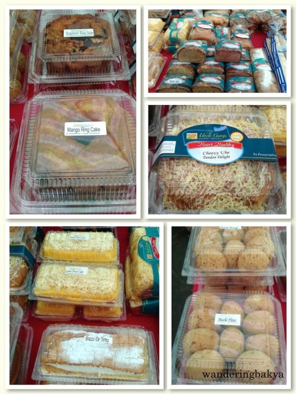 Uncle George Gourmet Bread (counterclockwise): mango ring cake, raspberry ring cake, blueberry cake, banana cake, cheezy ube pandan delight, country raisin, Frnech baguette, plain mochi, mochi floss, yema cheesecake, and brazo de yema.