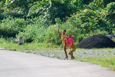 Children running to the road to shout out a 'hello'! as we pass by