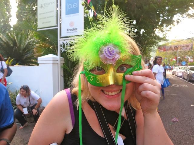 Girl in green mask at Seychelles Carnival