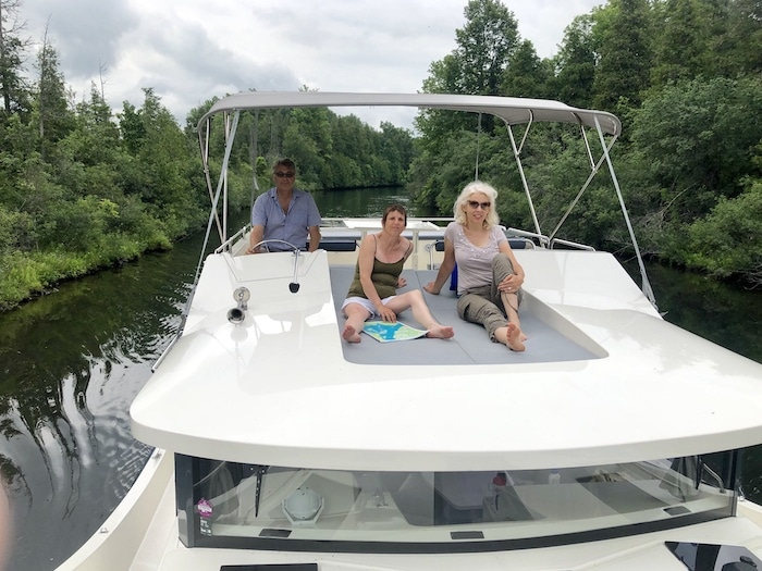 Driving our Le Boat cabin cruiser rental on the Rideau Canal in Ontario