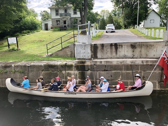 Voyageur canoe at Chaffey's Lock, Rideau Canal, Ontario