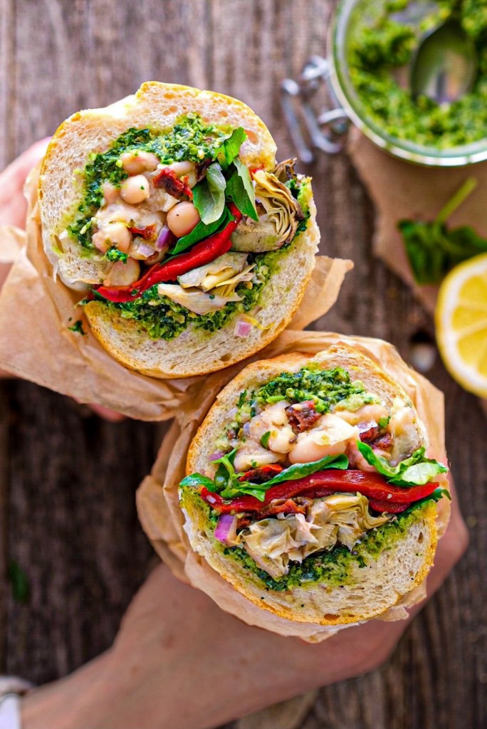This vegan antipasto sandwich is loaded with creamy marinated white beans, sunflower pesto, artichoke hearts and roasted red peppers. It makes for the perfect healthy vegan lunch.