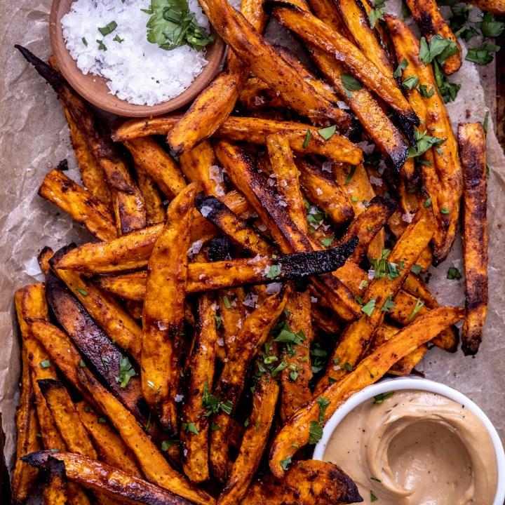 smoky oven baked sweet potato fries with maple tahini sauce