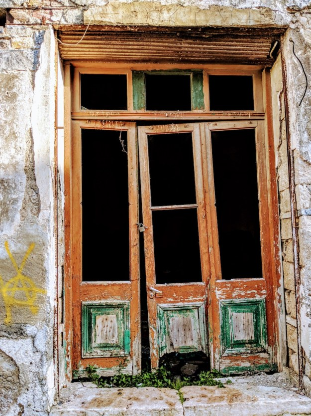 Working in Samos refugee camp in Greece with an NGO called Samos Volunteers. Old European doors on Samos, Greece.