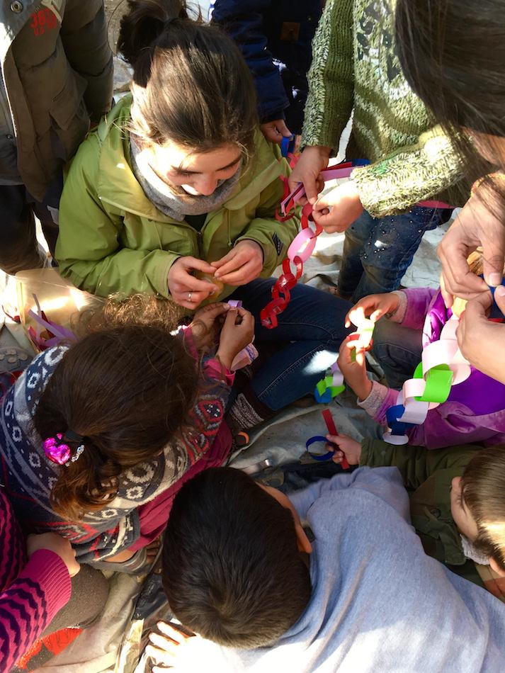 Kid's activities in a refugee camp. Volunteering in a refugee camp