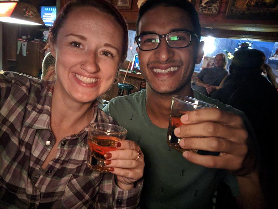 Susanna and Ganesh drinking at a bar in Seward