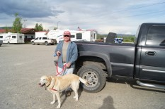 Henry is loaded for bear with his dirty truck, trusty guard dog and $13 six pack of Canadian beer. Note to Lenoard: Bud Light is the same price.