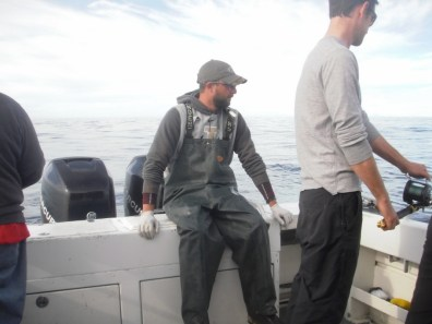 Captain Seth takes a break while Jonathan fishes
