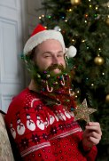 """London based artist Katya Wildman has given beards a seasonal makeover to mark the launch of the new Samsung Galaxy Note Edge handset. The festive fashion project took six hours to complete and feature seasonal staples including a Christmas tree, robin red breast, mistletoe, glitter, snow and icicles. Katya commented, """"I have always been fascinated by facial hair – and now I have the chance to try out my festive designs on some bounteous beards. I used the Galaxy Note Edge to photograph the models and create a series of portraits that I hope will raise a smile this festive season!"""" Pix:Tim Anderson FREE PHOTO USAGE"""