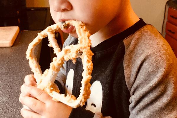 little boy licking spoon