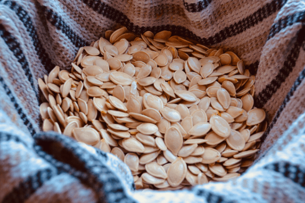 rinse and dry pumpkin seeds