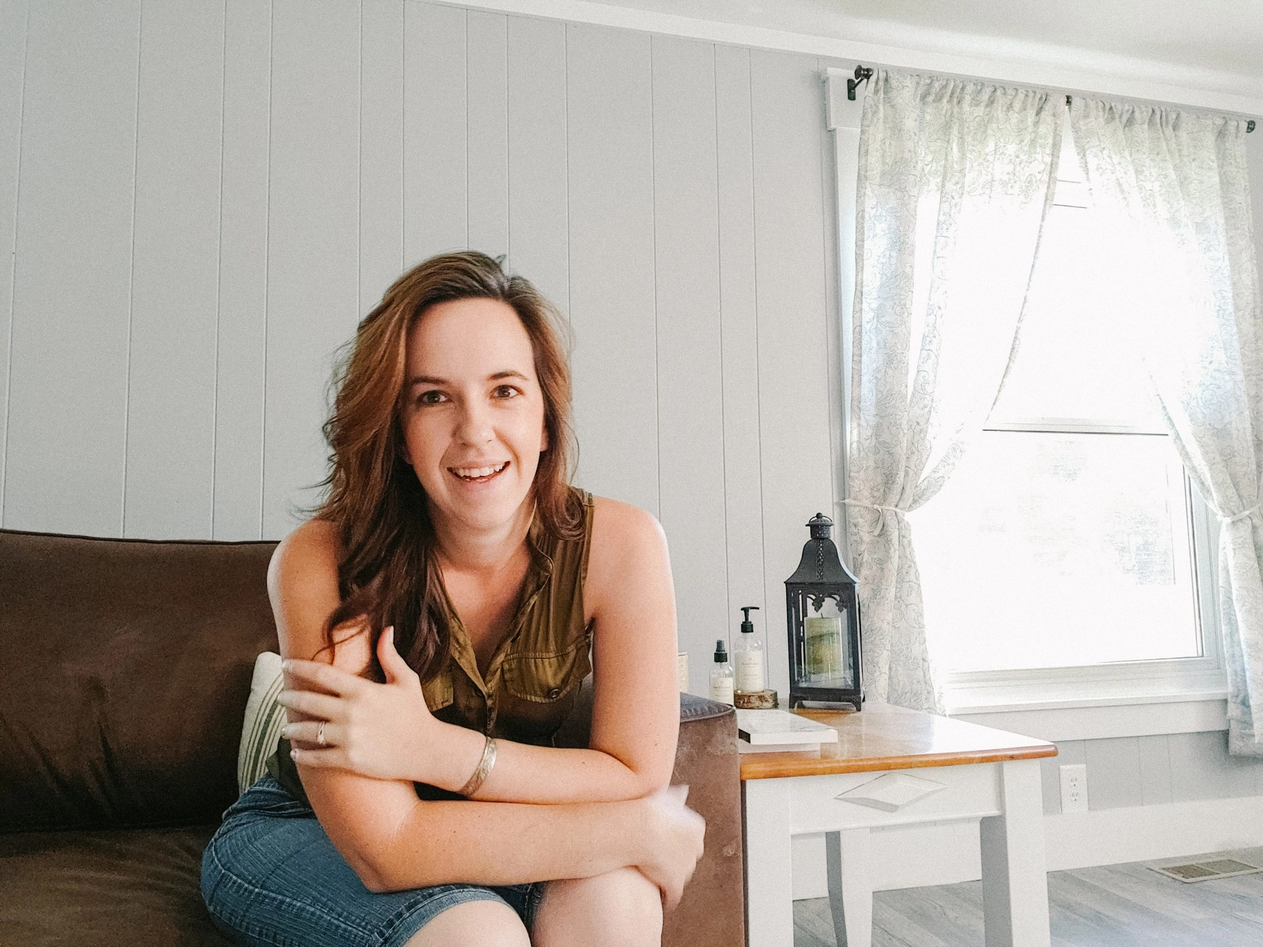 Leah Lynch of Leahs lovely lops sitting on her couch smiling friendly