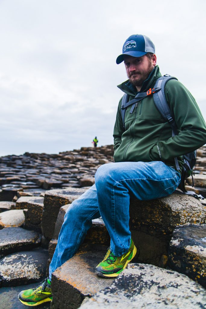 man sitting on columns giants causeway
