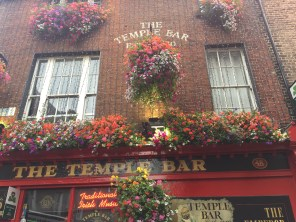 The Temple Bar in the heart of Dublin charms tourists with its colorful facade and exciting interior.