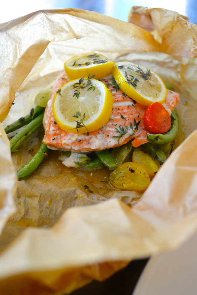 Salmon en Papillote - salmon in parchment paper with green beans, lemon, and tomatoes