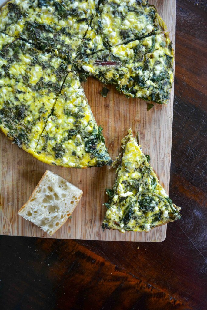 A power breakfast recipe - Eggs baked with beet greens, swiss chard, garden herbs and feta cheese