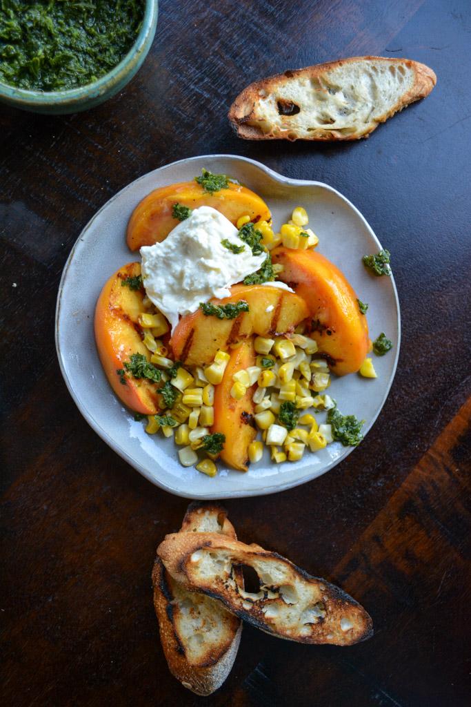 Grilled peaches and corn with creamy burrata and crispy baguette - the perfect peach crostini recipe!