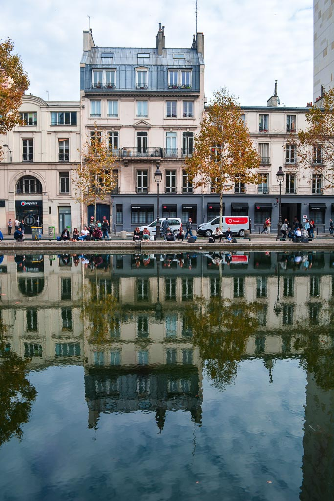 Building reflections in the Canal St. Martin in Paris, France