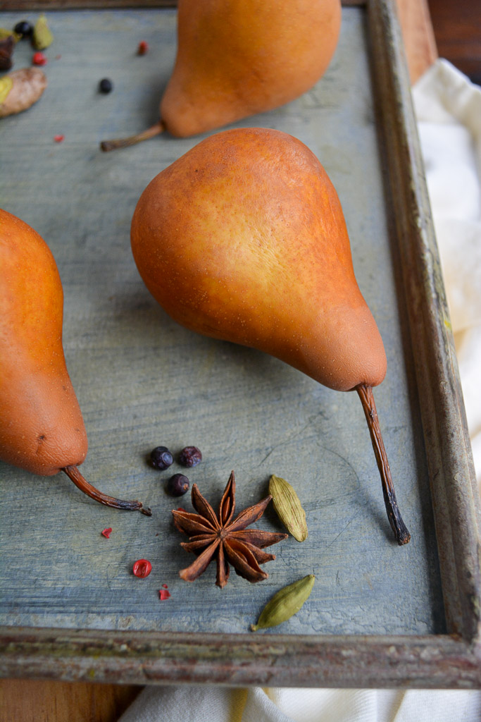 Pears with star anise, cardamom pods, and allspice berries - Spiced Red Wine Poached Pears