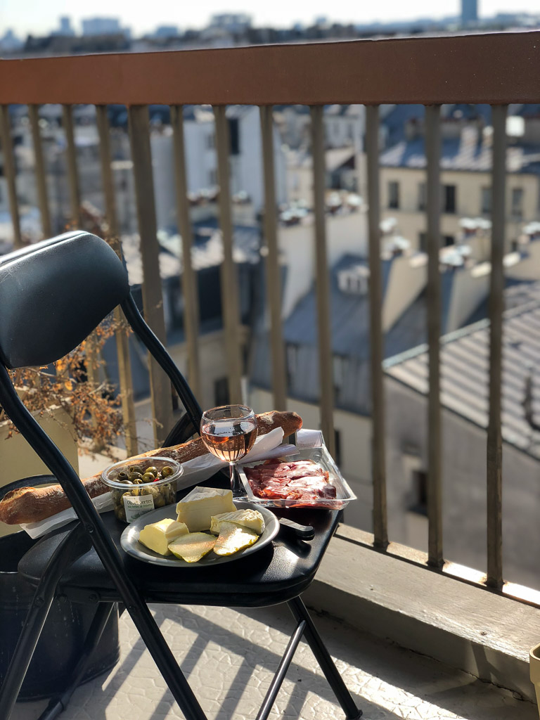 Comprehensive Guide to Paris: Picnic makings on a balcony in Paris