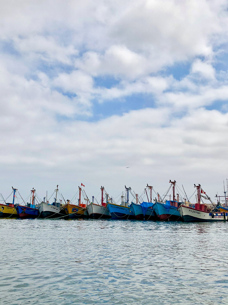 Boats on the ocean in Paracas
