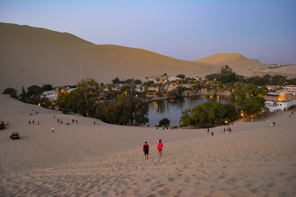 Desert oasis of Huacachina at sunset in Ica, Peru