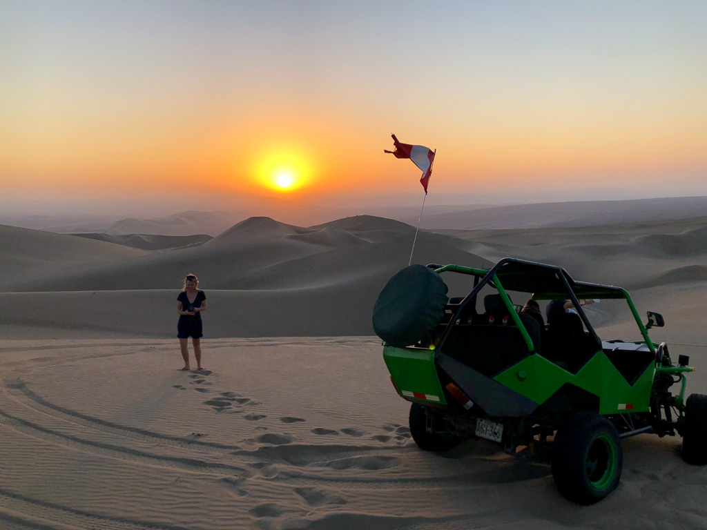 Sunset in the sand dunes in Huacachina, Peru