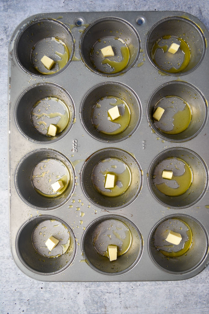 Greased muffin tin with butter