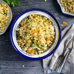 Moroccan Couscous Salad with Dried Apricots, Marcona Almonds, and lot of Fresh Herbs