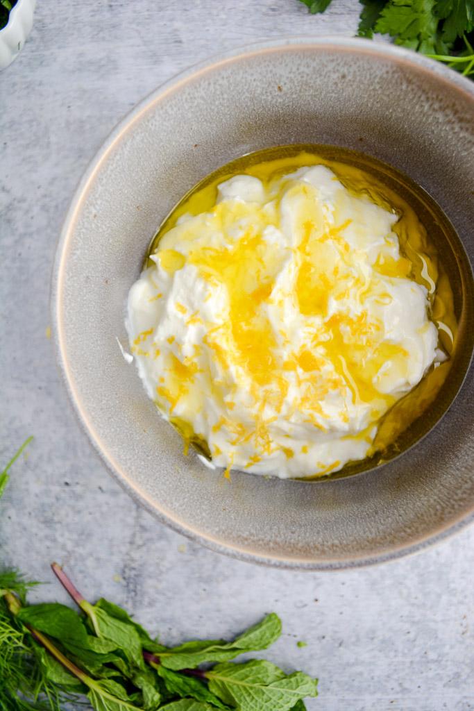 Creamy greek yogurt with lemon zest and olive oil