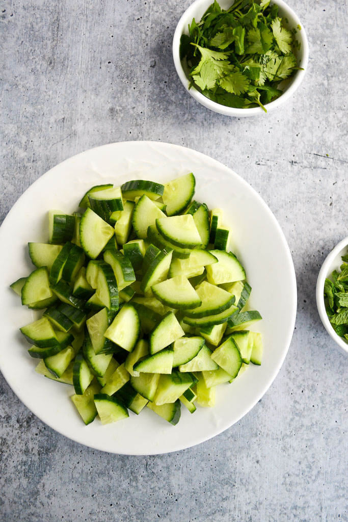 Sliced cucumber, and fresh mint