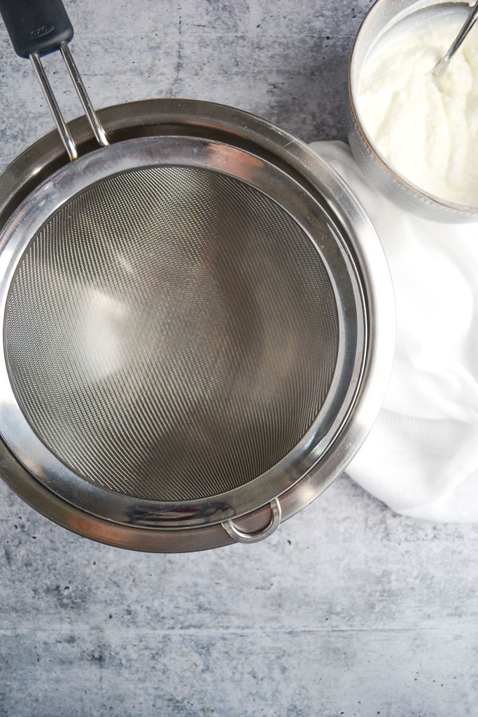 Fine mesh strainer over a bowl
