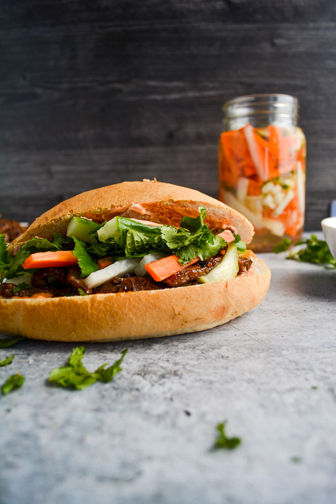 Banh Mi with Lemongrass Beef, Pickled Carrots, Pickled Daikon, Fresh Mint, Cilantro, and Sriracha Mayonnaise