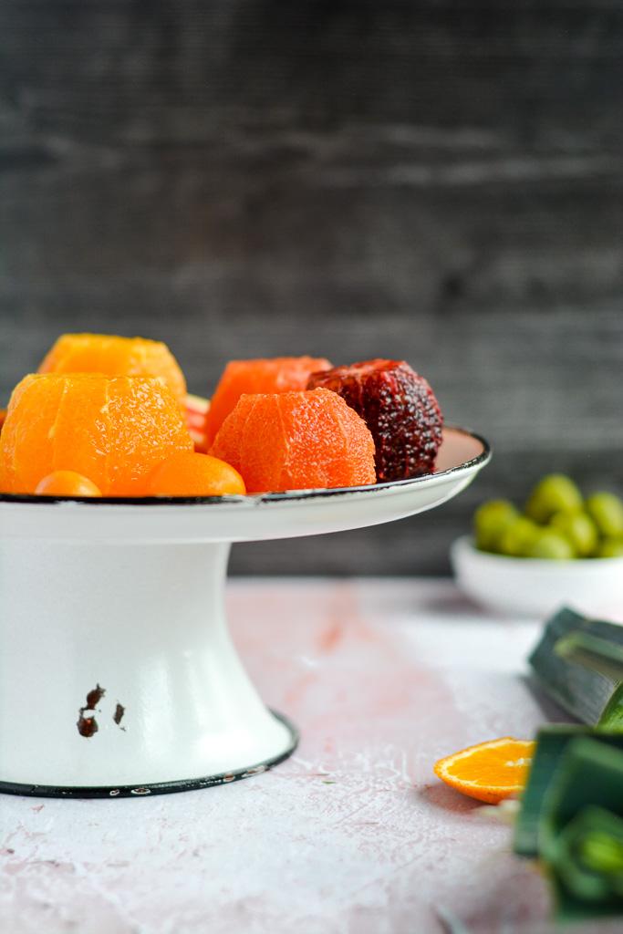 Segmented Cara cara oranges, blood oranges, navel oranges, and kumquats