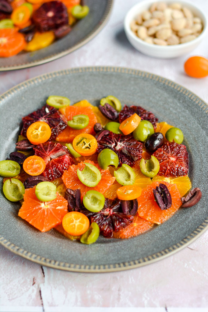 Cara cara oranges, blood oranges, navel oranges, and kumquats with castelvetrana olives