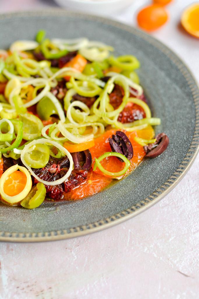 Cara cara oranges, blood oranges, navel oranges, and kumquats with castelvetrana olives and softened leeks